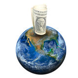 A dollar banknote on the earth. Elements of this image furnished b Stock Images