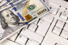 Dollar banknote on keyboard Stock Photos