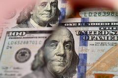 Dollar banknote through magnifying lens Stock Photos