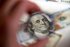 Dollar banknote through magnifying lens Stock Image