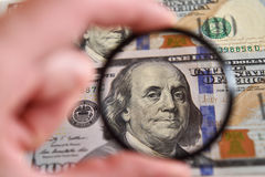 Dollar banknote through magnifying lens (corruption, lobbying, i Royalty Free Stock Photo