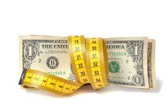 Dollar banknote and measure tape Royalty Free Stock Images