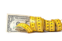 Dollar banknote and measure tape Royalty Free Stock Photo