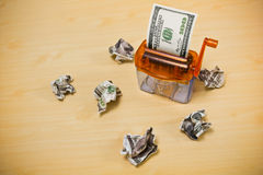 Dollar banknote in a paper shredder Stock Images