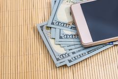 Dollar banknote with phone. Business concept Stock Images