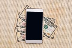 Dollar banknote with phone. Business concept Royalty Free Stock Photo
