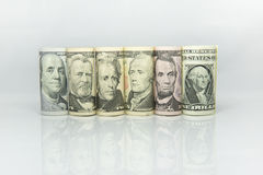Dollar banknote roll showed President of united of america on each banknote. Money American dollar bills.Pile of various currencies on white background.Closeup stock image