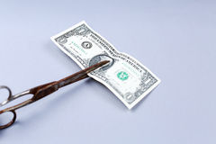 Dollar banknote and a scissors Royalty Free Stock Photo