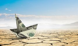 Bad times in business. Dollar banknote ship in desert as symbol for financial crisis Royalty Free Stock Photography