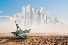 Bad times in business. Dollar banknote ship in desert as symbol for financial crisis Royalty Free Stock Photos