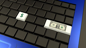 Dollar banknote and sign on the laptop keyboard Royalty Free Stock Photography
