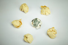 Dollar banknote surrounded by crumpled papers Royalty Free Stock Photos