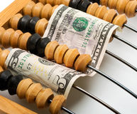Dollar banknote in wooden abacus Royalty Free Stock Photography