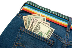Dollar banknotes. In a female`s blue jeans pocket Royalty Free Stock Images
