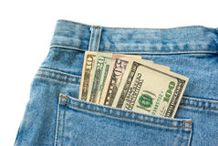 Dollar banknotes. 10 20 50 100 dollar banknotes in a blue jeans pocket isolated over white Stock Photography