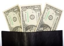 Dollar banknotes in black leather wallet Stock Photos