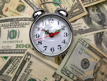 Dollar banknotes and clock Stock Image