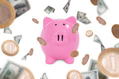Dollar Banknotes and Coins Falling Around Piggy Bank. Group of one hundred dollar banknotes and coins flying or falling around pink piggy bank, isolated on white Stock Photos