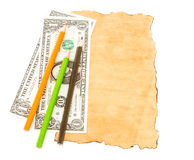 Dollar banknotes and colorful pencil on old paper Royalty Free Stock Photos