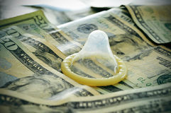 Dollar banknotes and condom Royalty Free Stock Photography