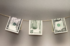 Dollar banknotes drying on rope. Photo concept Royalty Free Stock Photography