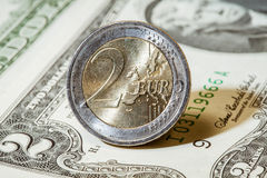 Dollar banknotes and euro coin Stock Image