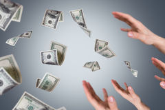 Dollar Banknotes Falling on Young Male Hands Stock Photography