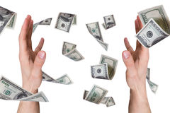 Dollar Banknotes Falling on Young Male Hands Stock Image