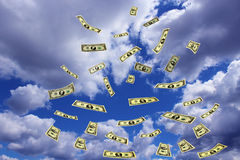 Dollar banknotes flying away in the sky Stock Photography