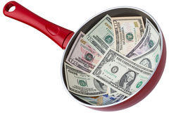 Dollar banknotes in a frying pan Royalty Free Stock Photos