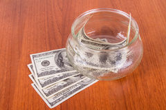 Dollar Banknotes in Glass Bowl Royalty Free Stock Image