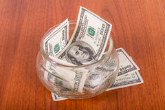 Dollar Banknotes in Glass Bowl Royalty Free Stock Photos