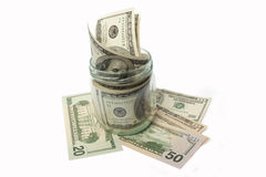 Dollar banknotes in a glass jar Royalty Free Stock Images