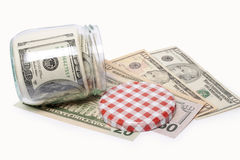 Dollar banknotes in a glass jar Stock Photography