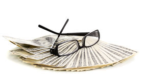Dollar banknotes and glasses Royalty Free Stock Images