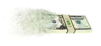 Dollar banknotes going up in smoke. 