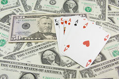 Dollar banknotes and holdem poker cards. Dollar banknotes and full house holdem poker cards Royalty Free Stock Photography
