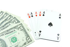Dollar banknotes and holdem poker cards. Dollar banknotes with face value 5 and holdem poker cards Royalty Free Stock Photo
