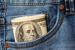 Dollar banknotes in jeans pocket. Stock Photo