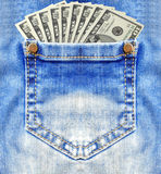 Dollar banknotes in jeans pocket closeup Royalty Free Stock Images