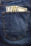 Dollar banknotes in jeans pocket closeup. Business concept. pocket money.  Royalty Free Stock Photos