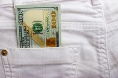 Dollar banknotes in jeans pocket closeup. Business concept. pocket money.  Stock Photography