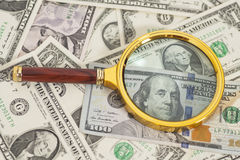Dollar banknotes with magnifying glass Stock Photos