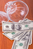 Dollar Banknotes out of Glass Bowl Stock Images