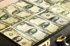Dollar banknotes packed into a briefcase or bag Royalty Free Stock Images