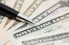 Dollar banknotes and pen Stock Photos