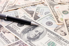 Dollar banknotes and pen Royalty Free Stock Photo