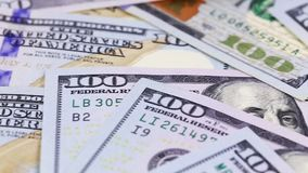100 dollar banknotes. In a pile stock footage