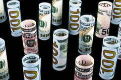 Dollar. Dollar banknotes roll in other positions. American US currency on black board. American dollar banknote rolls Royalty Free Stock Photo