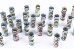 Dollar. Dollar banknotes roll in other positions. American US currency on white board. American dollar banknote rolls Stock Photos